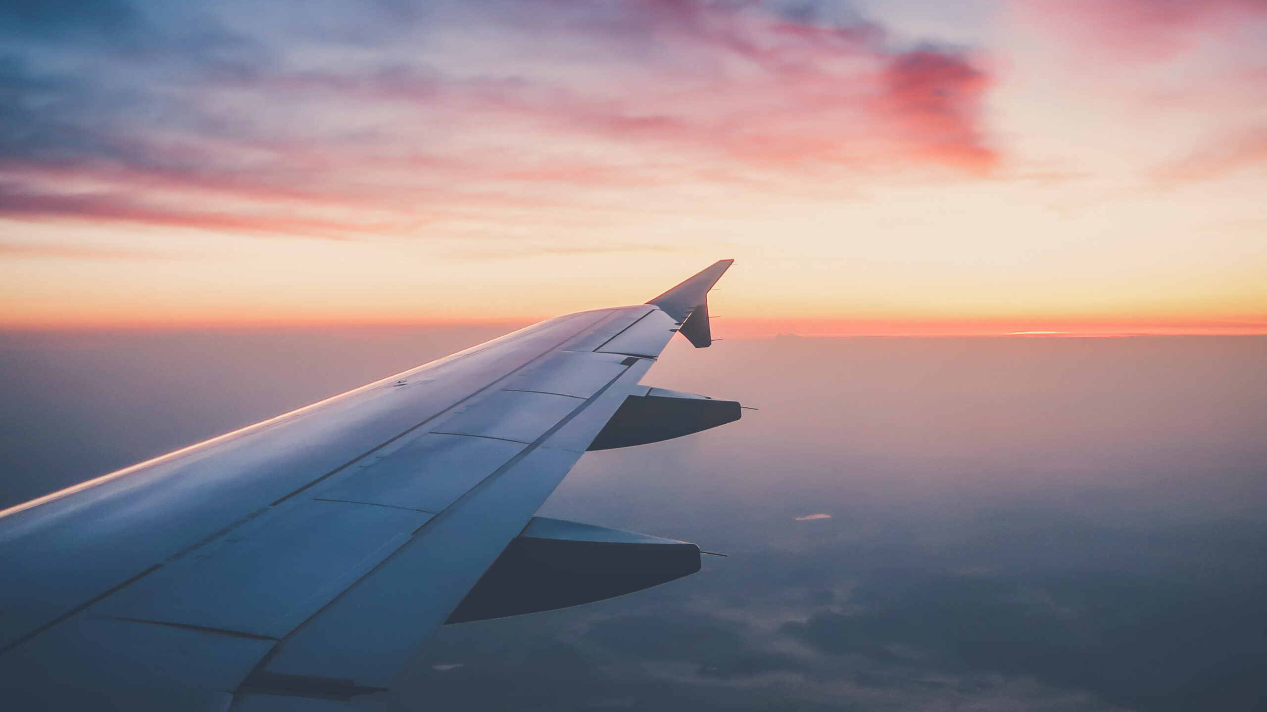 Sunset,From,Plane,With,View,Of,Wing